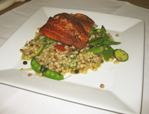 Alaskan Copper River salmon with Windflower Farm sugar peas and baby squash, on fregola pasta